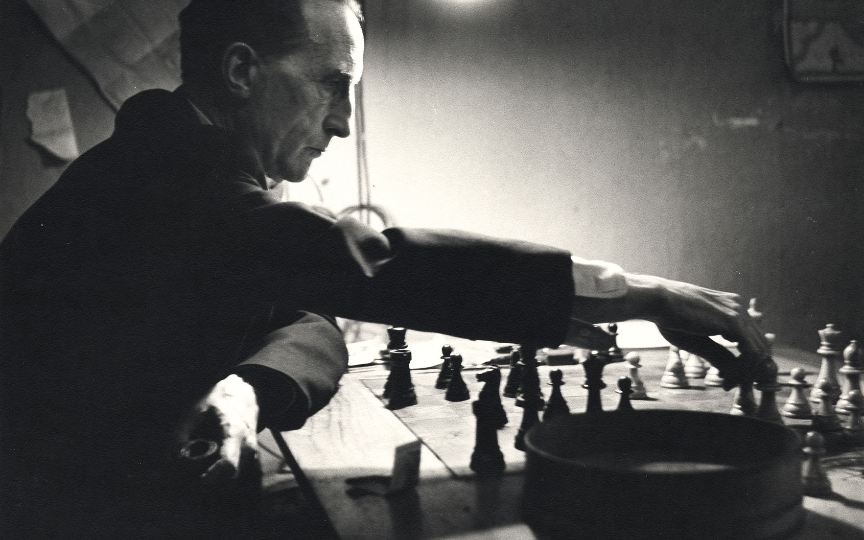 Marcel Duchamp playing chess in his studio (detail), 1952  Kay Bell Reynal, photographer. [Photographs of artists taken by Kay Bell Reynal], 1952. Archives of American Art, Smithsonian Institution