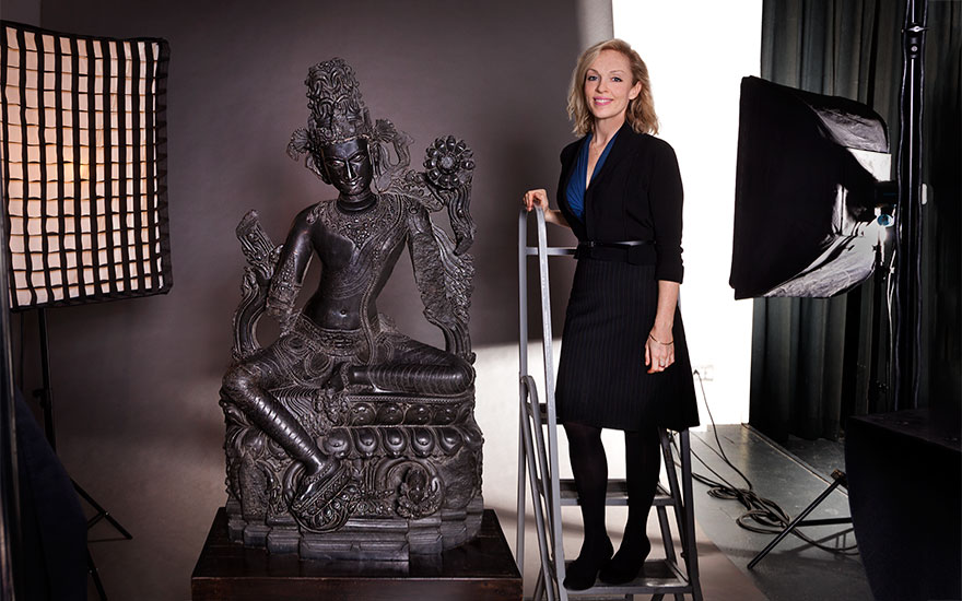 Leiko Coyle with a black stone figure of Lokanatha (Avalokiteshvara) which sold for a world record-breaking $24,663,500