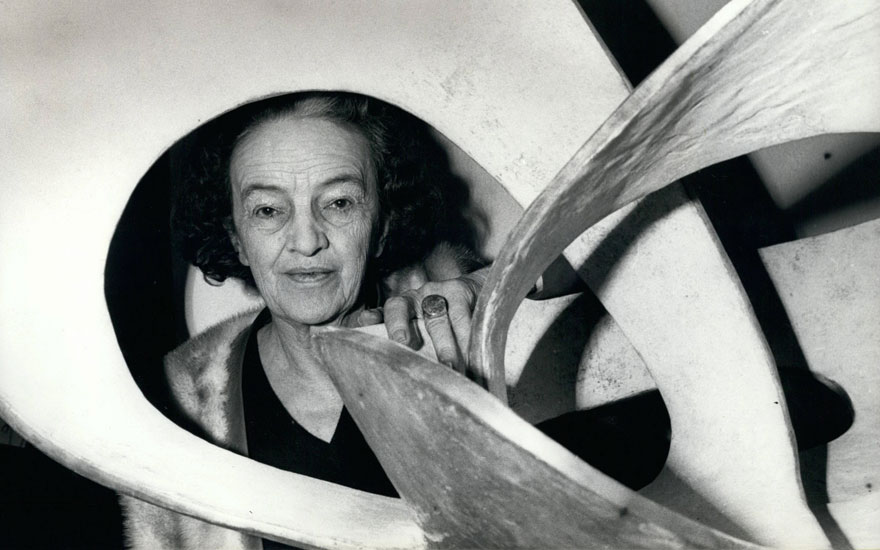 Barbara Hepworth photographed with Forms in Movement (Pavan) (1967) at her retrospective at the Tate Gallery, London, in 1968. Keystone Pictures USAREXShutterstock. Artwork © Bowness