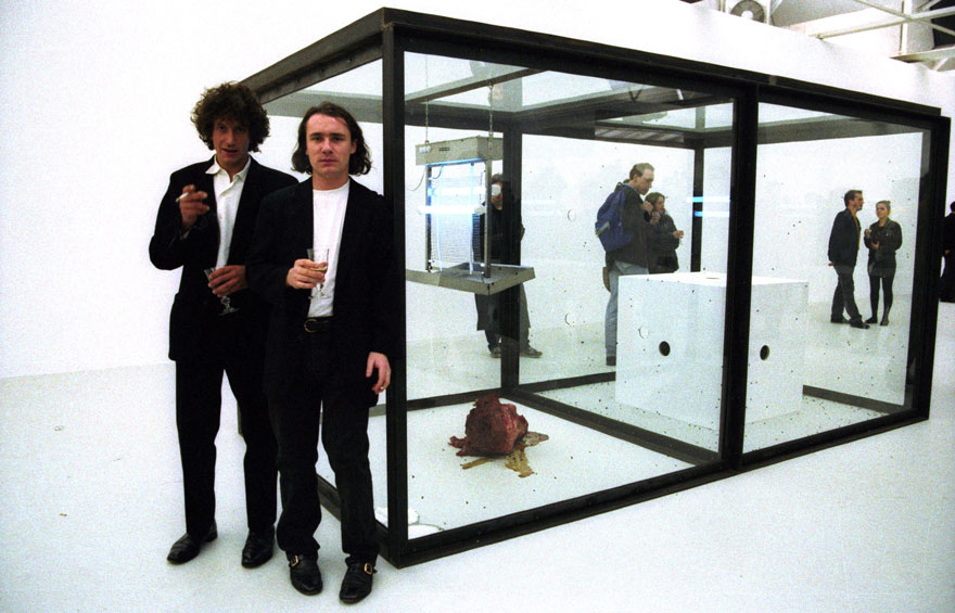Damien Hirst and Danny Chadwick photographed with Hirst's 1990 work A Thousand Years, at Young British Artists I, a group exhibition at the Saatchi Collection, London, March 1992. Photo