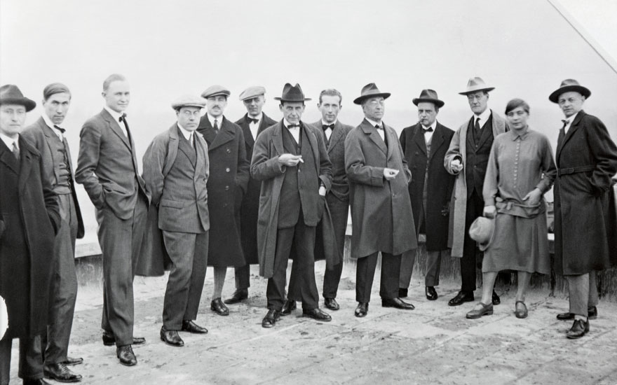 Masters on the roof of the Bauhaus building, 4-5 December 1926 (reproduction 1998). (Left to right) Josef Albers, Hinnerk Scheper, Georg Muche, László Moholy-Nagy, Herbert Bayer, Joost Schmidt,
