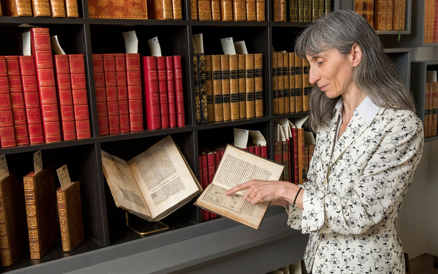 Barbara Scalvini with a first edition of Tycho Brahe's De nova… stella. Offered in Important Scientific Books from the Collection of Peter and Margarethe Braune on 9 July 2019 at