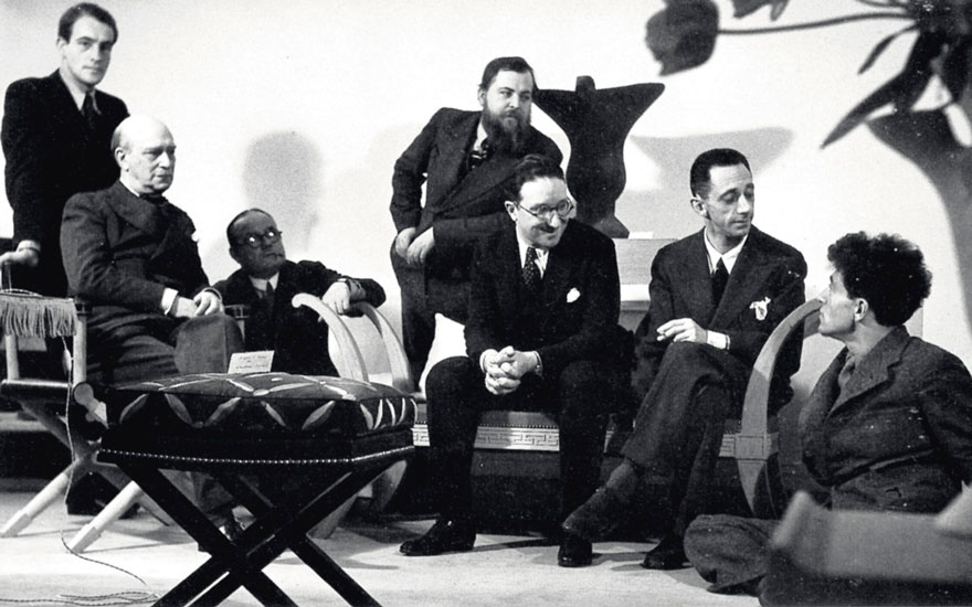 Jean-Michel Frank (second from right) in conversation with Alberto Giacometti (far right) in his boutique on Rue du Faubourg Saint-Honoré, Paris, 1935. Also in the group are Paul Rodochanachi,