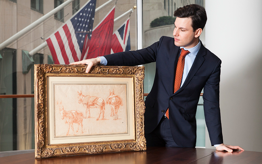 Christie's Old Masters specialist Furio Rinaldi with Giovanni Battista Tiepolo's Three studies of a donkey