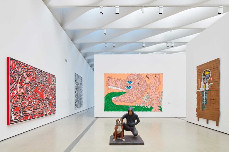 In foreground John Ahearn, Raymond and Toby, 1989; From left, Keith Haring, Red Room, 1988; Keith Haring, Untitled, 1984; Jean-Michel Basquiat, Gold Griot, 1984. © John Ahern. Keith Haring artworks © Keith Haring Foundation © The Estate of Jean-Michel Basquiat  ADAGP, Paris  ARS, New York 2016