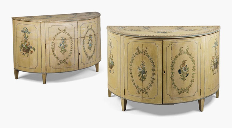 A close pair of George III polychrome-decorated demi-lune commodes. Early 19th century. Each 32 in (81.5 cm) high; 48 in (122 cm) wide; 21 in (53 cm) deep. Sold for £11,250 on 17 August 2016 at Christie's in London