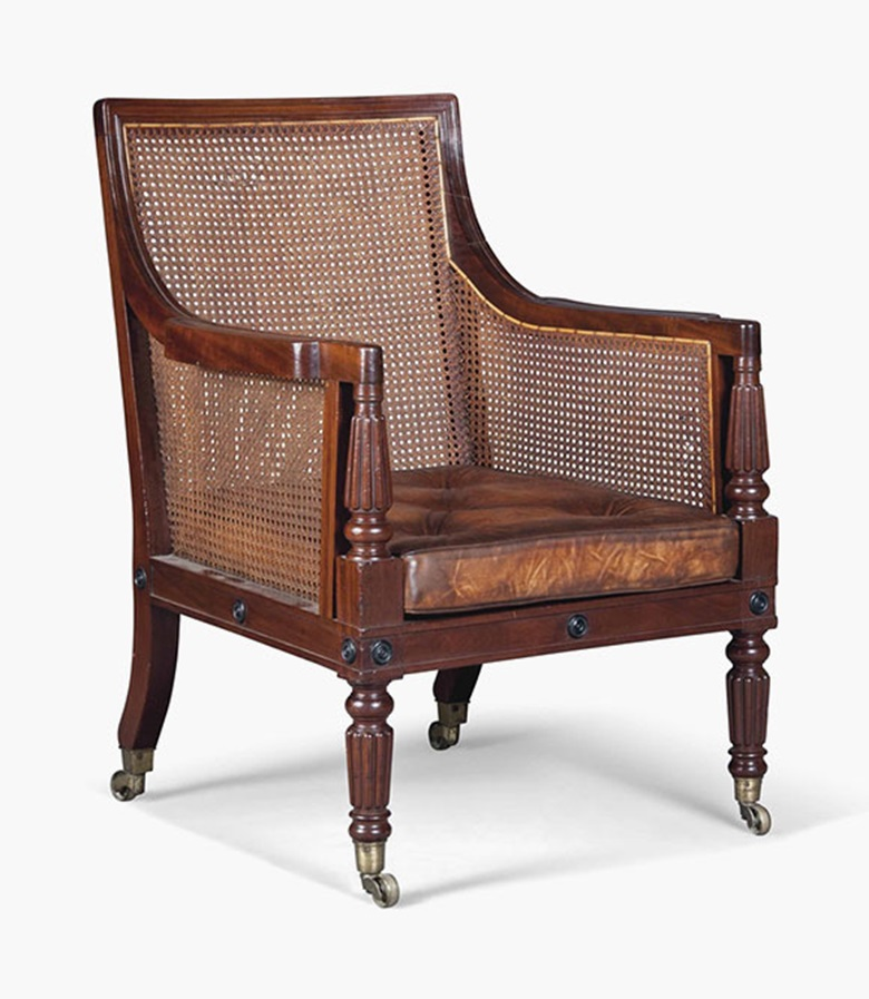 A Regency mahogany caned library bergère. Early 19th century. 37½ in (95 cm) high; 25½ in (65 cm) wide. Sold for £3,500 on 17 August 2016 at Christie's in London