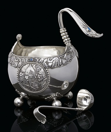 An impressive gem-set silver kovsh and ladle. Marked K. Fabergé with the Imperial warrant, Moscow, 1899-1908. The kovsh 13⅝ in (34.6 cm) high; the ladle 10¼ in (26 cm) long. This lot was offered in Russian Art on 5 June 2017 at Christie's in London and sold for £87,500