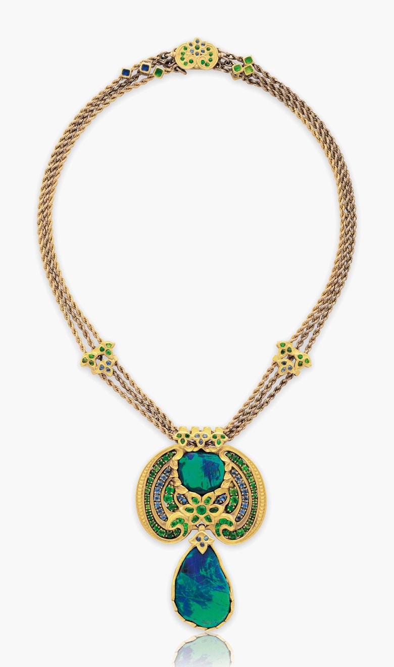 A black opal, demantoid garnet, sapphire and enamel necklace by Louis Comfort Tiffany, Tiffany & Co. Estimate $90,000-120,000. This lot is offered in Magnificent Jewels & the Rockefeller Emerald on 20 June 2017, at Christie's in New York