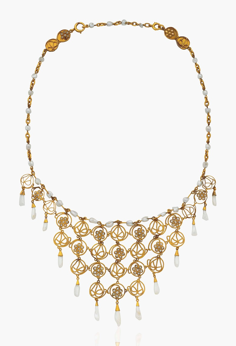 A delicate pearl and gold bib necklace by Louis Comfort Tiffany, Tiffany & Co. Estimate $20,000-30,000. This lot is offered in Magnificent Jewels & the Rockefeller Emerald on 20 June 2017, at Christie's in New York