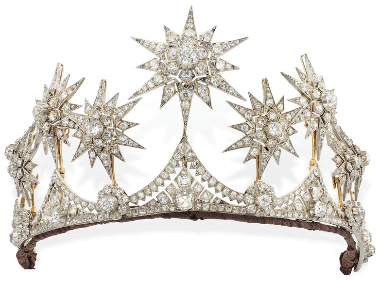 A Victorian diamond star parure, circa 1870. Comprising a tiara, the front set with six graduated old-cut diamond flowerhead clusters, each interspersed by an old-cut diamond collet and similarly set graduated triangular intersections, surmounted by nine detachable star motifs, mounted in silver and gold. 30 cm. Sold for £317,000 on 13 June 2017  at Christie's in London