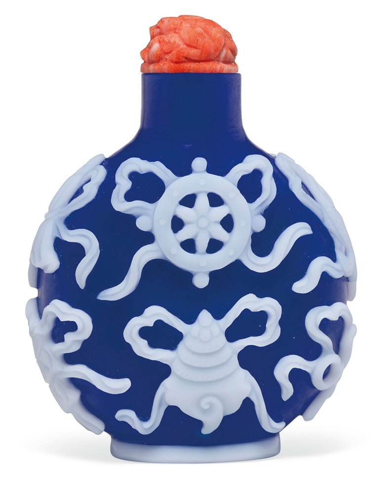 A white-overlay blue glass snuff bottle, probably imperial, Palace Workshops, Beijing, 1760-1820. 2⅜ in (6 cm) high. Estimate $12,000-15,000. Offered in The Ruth and Carl Barron Collection of Fine Chinese Snuff Bottles Part VI  on 12 September at Christie's in New York