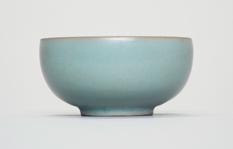 An important and extremely rare Ru 'sky-blue' tea bowl, Northern song dynasty, late 11th-early 12th century. 4  in (10.2  cm)  diam, Japanese wood boxes, one inscribed Seiji Chawan (celadon tea bowl). Estimate on request. Offered in Beyond Compare A Thousand Years of the Literati Aesthetic (Evening Sale) on 26 November 2018 at Christie's in Hong Kong
