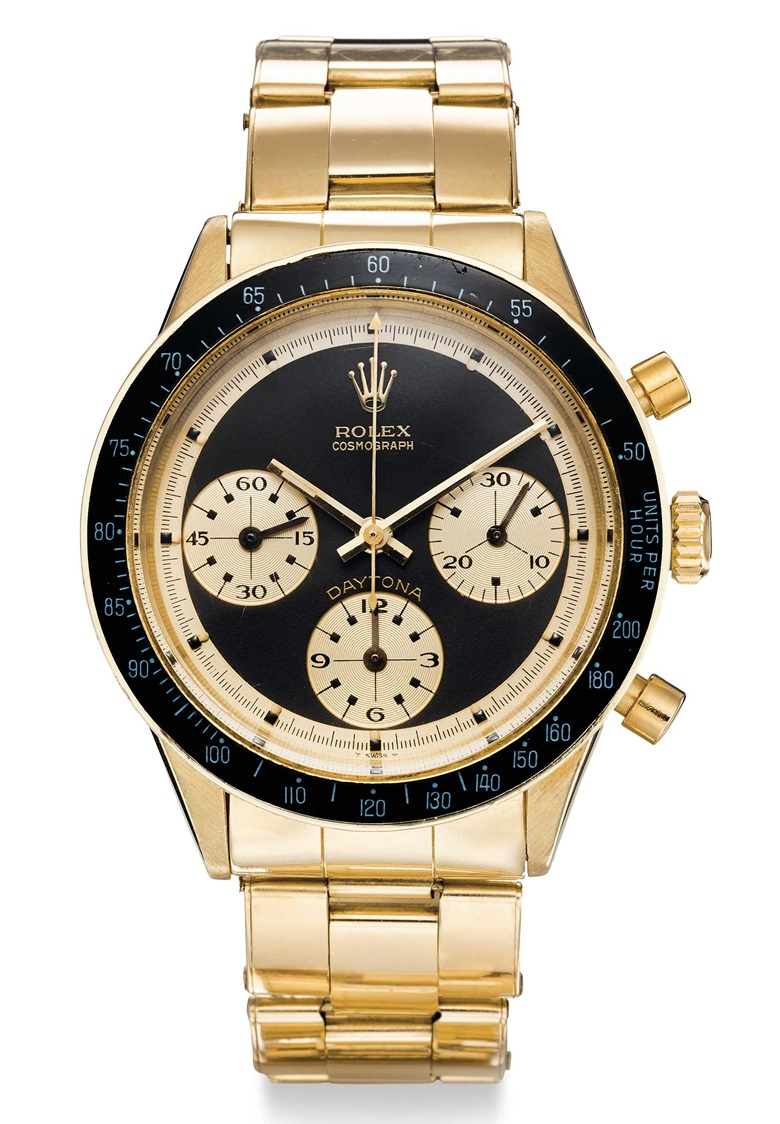 Rolex. An extremely fine and very rare 14k gold chronograph wristwatch with black 'John Player Special Paul Newman' dial and bracelet. Signed Rolex, Cosmograph, Daytona, John Player Special Paul Newman Model, Ref. 6241, Case No. 2084215, circa 1968. Price realised $552,500 on 6 December 2018 at Christie's in New York