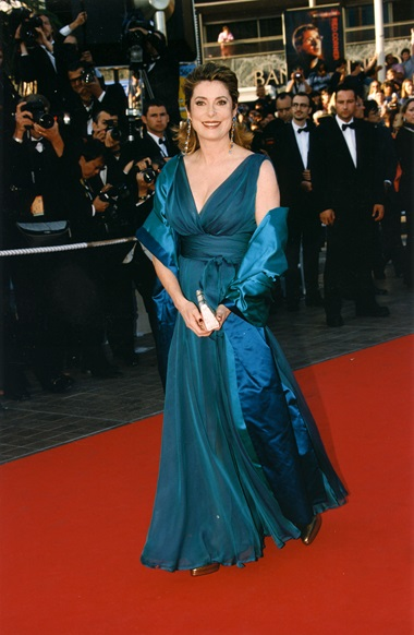 Catherine Deneuve wearing a YSL blue chiffon evening dress at the Cannes Film Festival in 1997. Photograph Getty Images