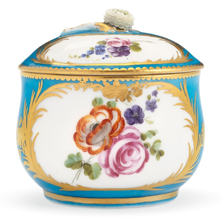 A Vincennes porcelain bleu celeste sugar bowl and cover, circa 1753-54. Painted with flower sprays within gilt cartouches of grasses and trailing flowers. Estimate $2,000-3,000. Offered in The Collector English & European 18th & 19th Century Furniture, Ceramics, Silver & Works of Art on 9 April 2019 at Christie's, New York