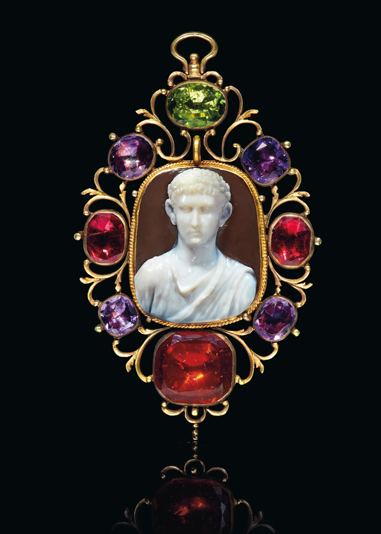 A Roman sardonyx cameo with a draped bust of a Julio-Claudian prince, circa early 1st century AD. Cameo 1 716  in (3.6  cm) long; mount 3⅞  in (9.8  cm) long. Sold for $350,000 on 29 April 2019 at Christie's in New York