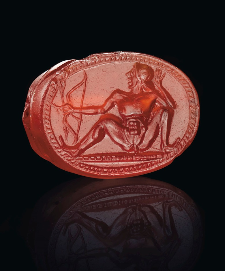 A Greek carnelian scarab with a nude archer, Archaic period, circa early 5th century BC. 38  in (1  cm) long. Sold for $47,500 on 29 April 2019 at Christie's in New York