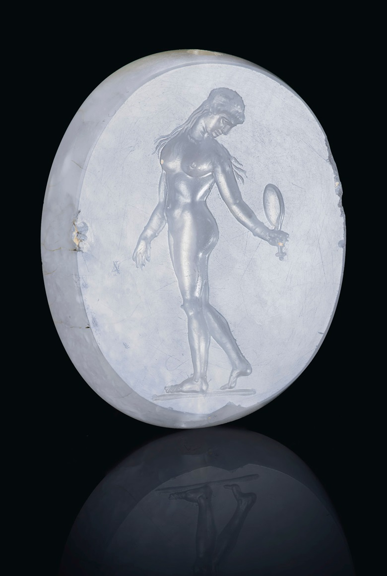 A Greek blue chalcedony scaraboid with Aphrodite, Classical period, circa 4th century BC. 1⅛  in (2.7  cm) long. Sold for $187,500 on 29 April 2019 at Christie's in New York