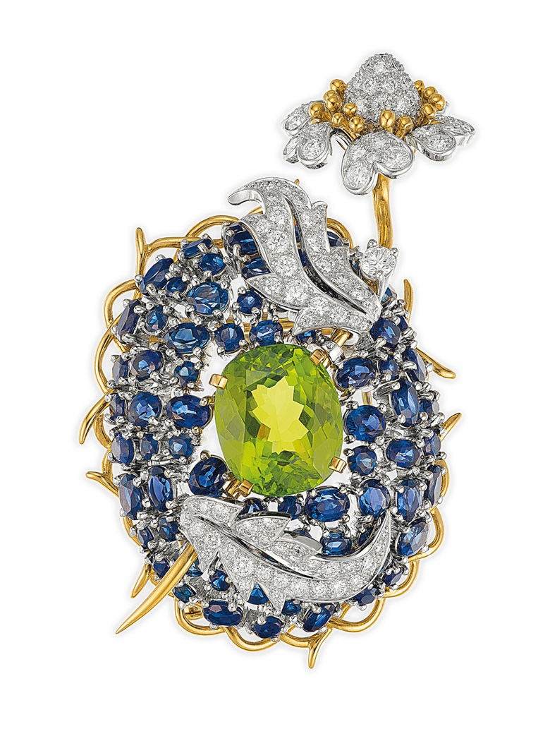 A peridot, sapphire and diamond 'Bluet' brooch by Jean Schlumberger, Tiffany & Co. Estimate $15,000-20,000. Offered in Elegance A Collection from the Estate of Jean Tailer, part of Magnificent Jewels on 16 April at Christie's in New York