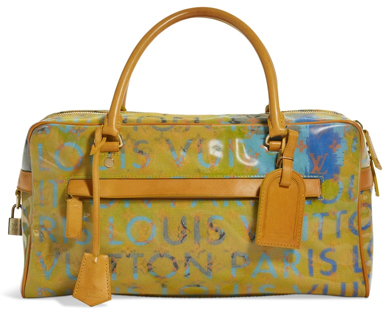 A limited edition denim & jaune Patent Defile Weekender PM by Richard Prince, Louis Vuitton, 2007. 40 w x 20 h x 13 d cm. Estimate $500-700. Offered in Handbags & Accessories, 28 May to 14 June 2019, Online