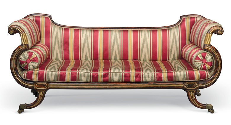 A Regency parcel-gilt and simulated-calamander sofa, circa 1815, redecorated. 36 in (91.5 cm) high; 80 in (203 cm) wide. Sold for £6,875 on 11 September 2019 at Christie's in London