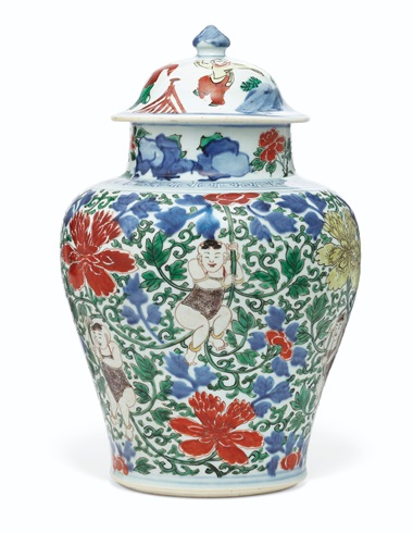 A wucai boys jar and cover, Shunzhi period (1644-1661). 14 ¾  in (38  cm) high, Japanese wood box. Estimate $15,000-25,000. Offered in Important Chinese Ceramics and Works of Art on 13 September 2019 at Christie's in New York