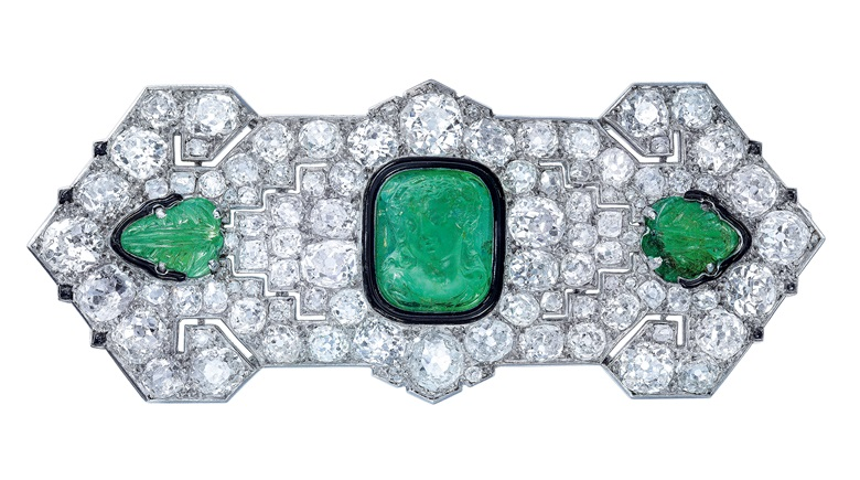 Art Deco emerald, diamond and onyx brooch, Cartier, cameo and carved emeralds, old and rose-cut diamonds, onyx, 1920s. 7.8 cm, signed Cartier Paris, no. 9602a. Sold for CHF 47,500 on 12 November 2019 at Christie's in Geneva