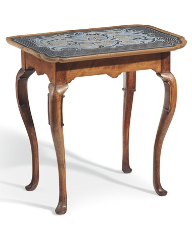 A German beechwood and beadwork centre table, Braunschweig, the beadwork attributed to Johann Michael Van Selow, circa 1740. The shaped rectangular beadwork top with stylised foliage on a striped ground, above a shaped apron, cabriole legs. 30¼ in (77 cm) high, 31in (79cm) wide, 21½ (54.5 cm) deep