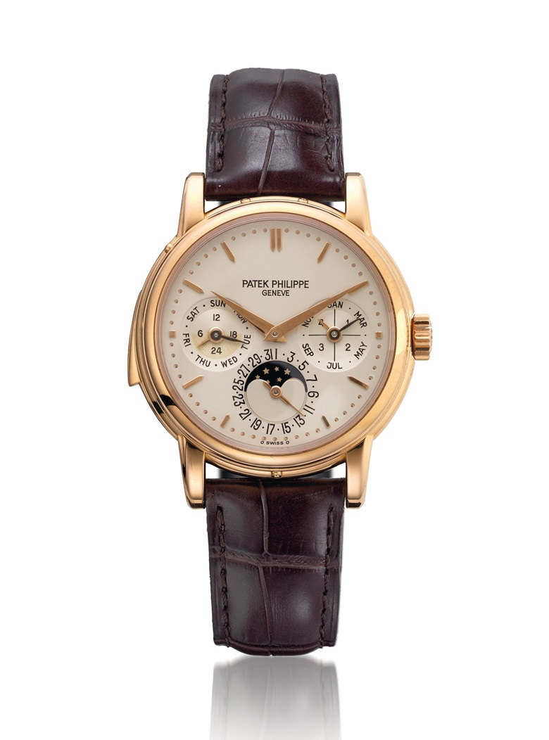Patek Philippe. An extremely fine, rare and important 18K pink gold automatic minute repeating perpetual calendar wristwatch with phases of the moon, additional white Roman dial, regular dial, case back, original certificate and box. Signed Patek Philippe, Genève, ref. 3974R, movement no. 1'906'091, case no. 2'962'726, movement manufactured in 1994, encased and sold in 2000. Estimate CHF 600,000