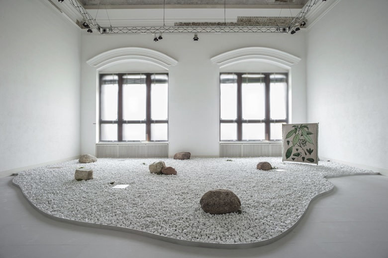 Otobong Nkanga, Taste of a Stone, 2020. Site-specific installation, boulders, gneiss, granite, Iceland lichen, inkjet prints on limestone, marble pebbles, movements, plants. Installation view Otobong NkangaTheres No Such Thing as Solid Ground, Gropius Bau, Berlin, 2020. © Otobong Nkanga, photo Luca Giradini