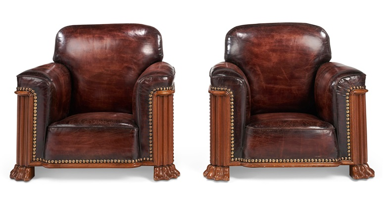 A pair of Art Deco mahogany and close-nailed leather upholstered club chairs. Offered in Christie's Living August Collections, 7-20 August 2020, online